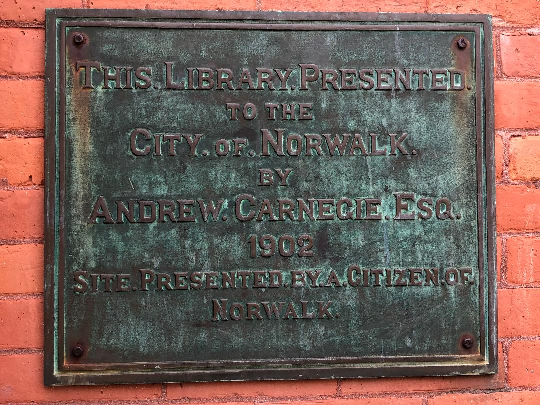 Plaque on Norwalk Connecticut library indicating it was presented to the people of Norwalk in 1902 by Andrew Carnegie.