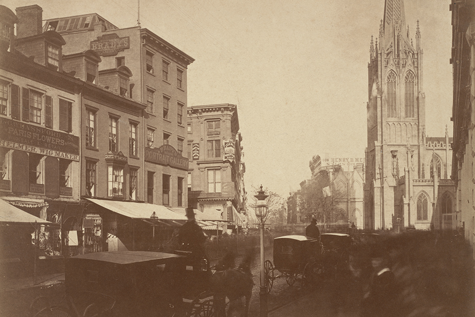 This vintage photo shows Mathew Brady's photography studio at the corner of Broadway and 10th street in New York City. Grace Church is across the street.