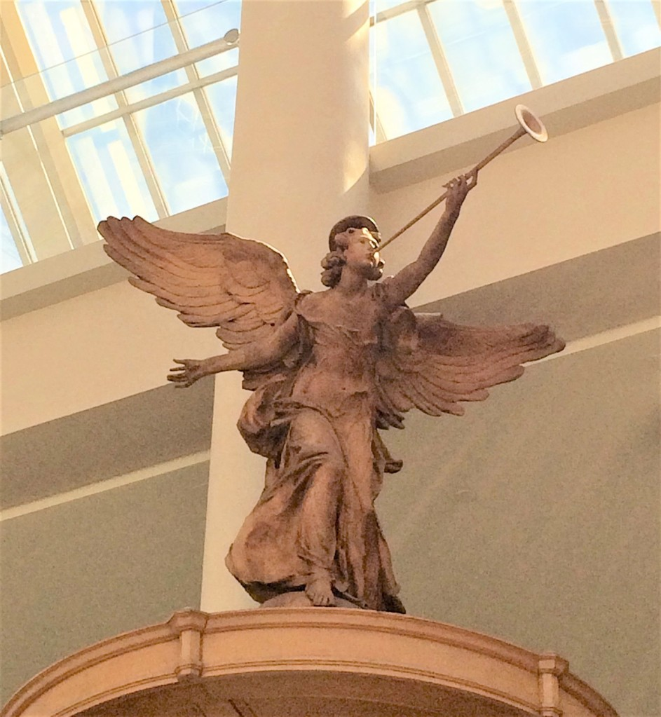 Carved angel from all angels church located atop pulpit on display in Metropolitan Museum of Art in New York City